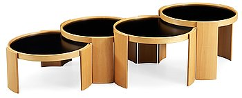 107. A Gianfranco Frattini stacking tables, (four pieces) with beech and laminate tops, by Cassina, Italy.