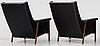 A pair of karl- erik ekselius black leather armchairs, joc, vetlanda early 1960's.