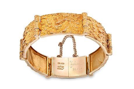 Björn weckström, a golden bracelet.