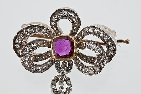 A diamond and ruby brooch.