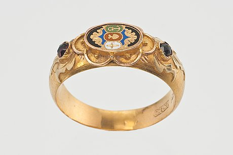A gold ring with enamel.