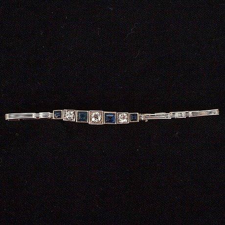 A gold bracelet.
