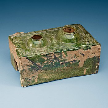 1442. A green glazed pottery model of a stove, Han dynasty  (206 BC– AD 220).