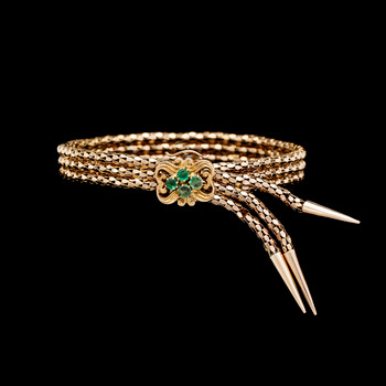 6. BRACELET, gold with small emeralds.