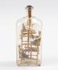 Flaska med figuriner, glas.