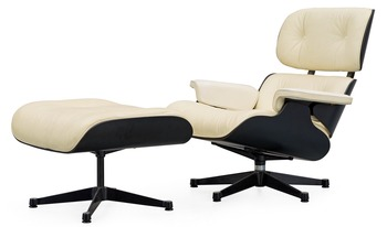 "1. A Charles & Ray Eames white leather ""Lounge Chair and ottoman"", Vitra."