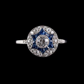 75. RING, 23 briljantslipade diamanter ca 0.67 ct. 12 fancy slipade safirer.