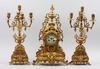 Bordspendyl samt kandelabrar, 3 delar, patinerad metall, nyresässans, sent 1800-tal.