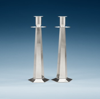 646. A pair of Wiwen Nilsson sterling candle sticks, Lund 1952 -56.