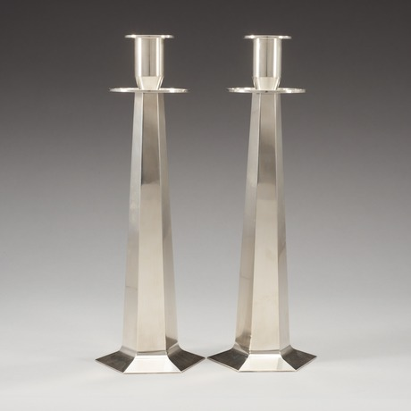 A pair of wiwen nilsson sterling candle sticks, lund 1952 -56.