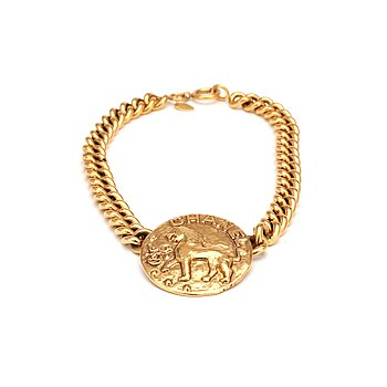 361. CHANEL, a gold colored chain necklace with medallion.