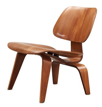 "8. A Charles & Ray Eames ""LCW"" easy chair, by Herman Miller."