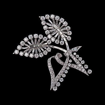 73. BROSCH, Van Cleef & Arpels. 146 briljant- och baguetteslipade diamanter ca 13.50 ct ~ G-H/vs.