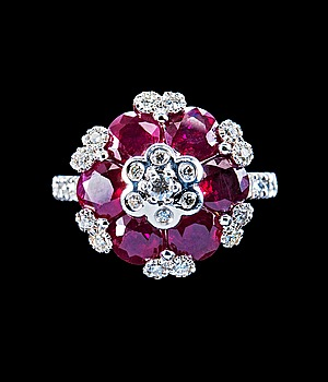 14. A RING, rubies c. 3.80 ct. brilliant cut diamonds c. 0.55 ct.