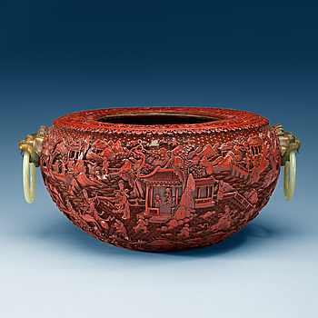 1499. A large red lacquer censer/basin with bronze beast and nephrite ring handles, Qing dynasty, with Qianlong seal-mark.