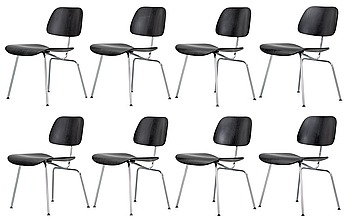 11. A set of eight Charles & Ray Eames 'DCM' chairs by Vitra.