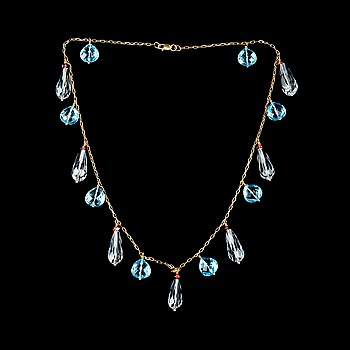 5. A NECKLACE, briolette cut rock crystal and topazes, garnets.