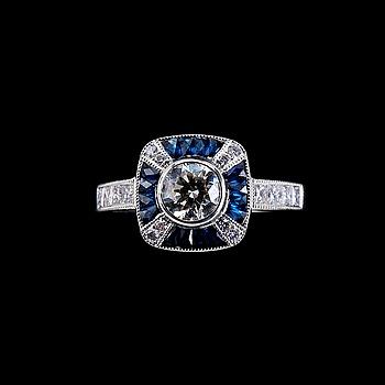 38. RING, briljantslipade diamanter 1 x 0.51 ct. och 0.36 ct. Fancy slipade safirer.