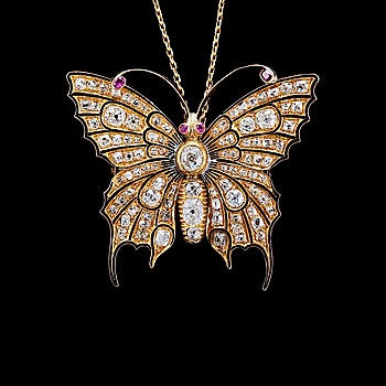 113. BROSCH, antikslipade diamanter ca 5.50 ct. 4 små smaragder.