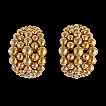 1024. A pair of Boucheron gold earclips.