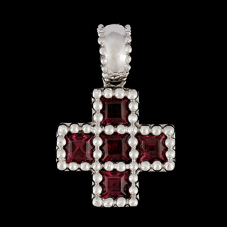 A tourmaline cross pendant.