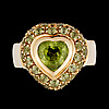 A heart cut peridote ring.
