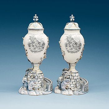 853. A pair of Swedish Marieberg faience vases with covers, 18th Century.