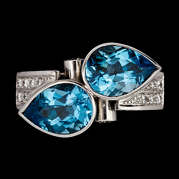 1. A blue topaz and brilliant cut diamond ring,