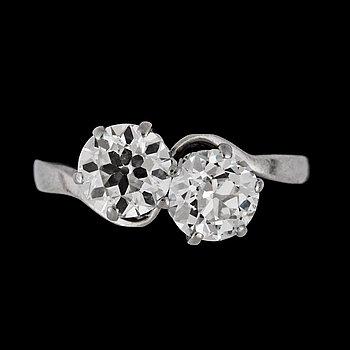 1053. An old cut diamond ring, each stone app. 1.10 cts.