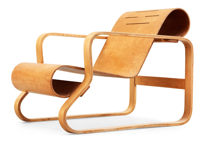 An Alvar Aalto Laminated Birch And Plywood Armchair Paimio