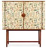A josef frank mahogany cabinet, doors and sides covered in frank's floral chintz fabric 'fatima', svenskt tenn ca 1937.