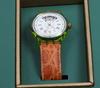 Olika konstnÄrer, objekt innehållande 5 signerade serigrafier samt swatch automativ gran via armbandsur.
