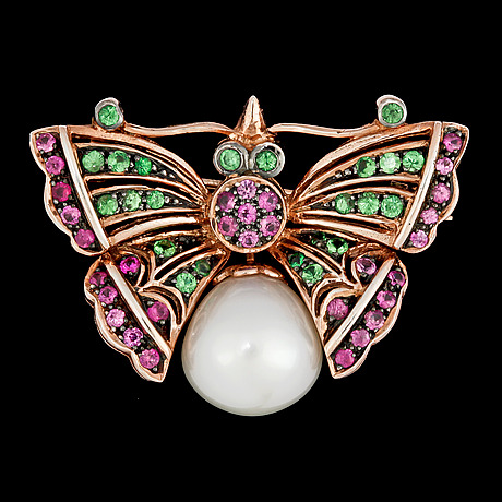 A butterfly brooch set with pink sapphires, tsavorites and cultured fresh water pearl.