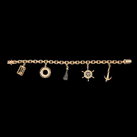A gold charm bracelet. weight 48 g.