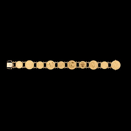 A spanish gold coin bracelet, weith 28 g.