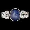 A cabochon cut blue sapphire and brilliant cut diamond ring, tot. 0.45 cts.