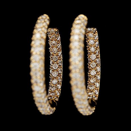 A pair of brilliant cut diamond earrings, tot. 3.29 cts.