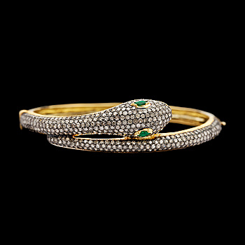9. A rose cut diamond bangle, with eyes of tsavorites, tot. app. 4 cts.