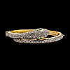 A rose cut diamond bangle, with eyes of tsavorites, tot. app. 4 cts.