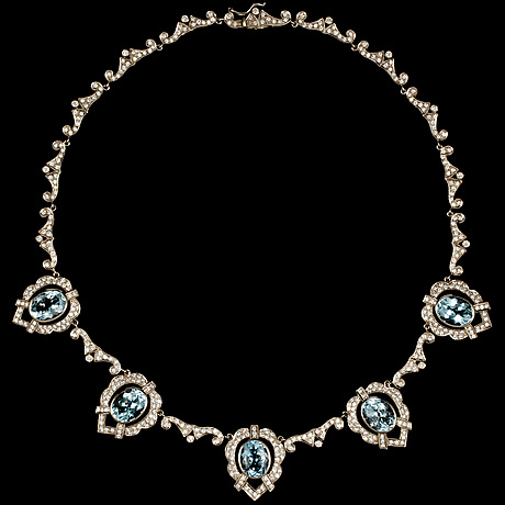 An aquamarine, tot. app. 20 cts and diamond necklace, tot. app. 5 cts.