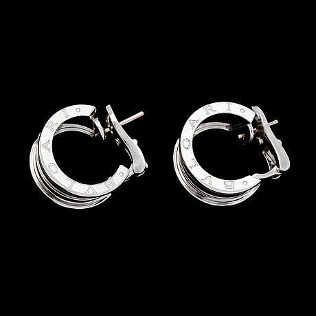 A pair of bulgari bzero1 earrings.