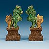 A pair of brown, green and yellow glazed joss stick holders, qing dynasty (1644-1912).