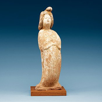 1444. A pottery figure of a elegant female courtier, Tang dynasty (618-907).