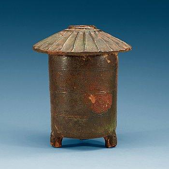 1441. A green glazed grain storage, Han dynasty (206 BC – AD 220).