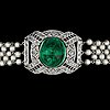 A cabochon cut emerald, rose cut diamonds and natural pearl bracelet, c. 1915.