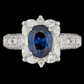 1054. A blue sapphire, tot. app. 1.30 cts, and brilliant cut diamond ring, tot. app. 1 ct.