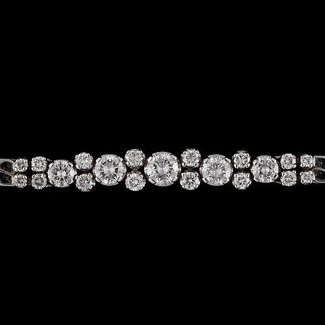A brilliant-cut diamond bracelet, total carat weight circa 2.00 cts.