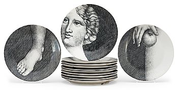 9. A Piero Fornasetti set of twelve 'Eva' porcelain plates, Milano, Italy.