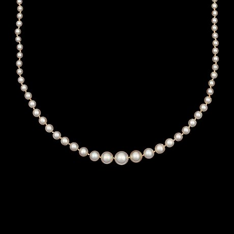 A oriental pearl, 7.4-3mm in diameter, necklace. clasp set with marquise- and brilliant-cut diamonds app. tot. 0.70ct.