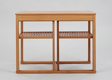 A carl malmsten teak set of occasional tables.